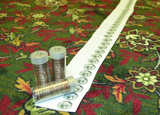 Mile of quarters leads to a Senior Center full of new carpet