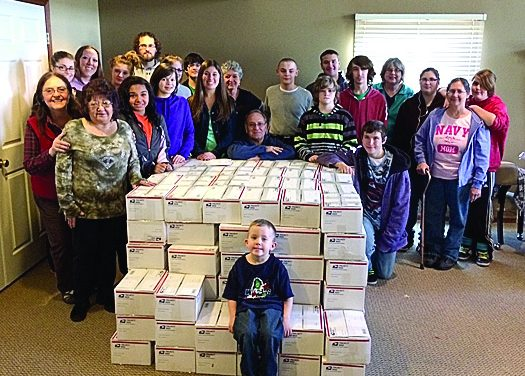 Volunteers pack nearly 200 holiday packages to send troops overseas