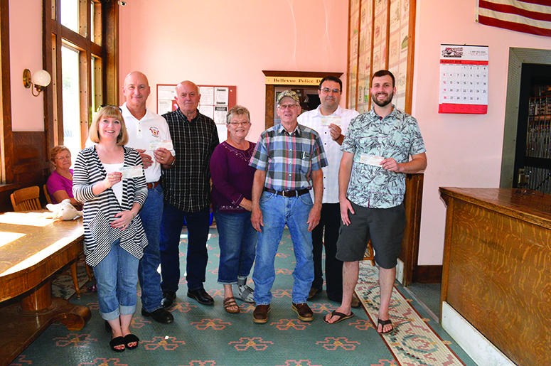 Bellevue Antique Tractor Show  Committee donates to local organizations