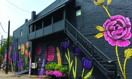 Artist decorates Mason with floral murals