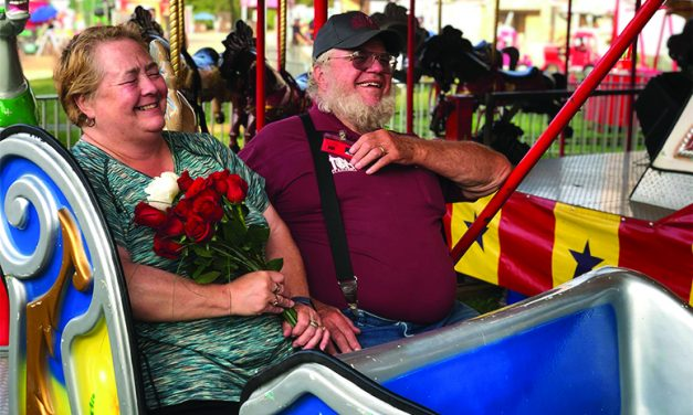 Longtime Fair Board member  renews vows on Merry Go Round