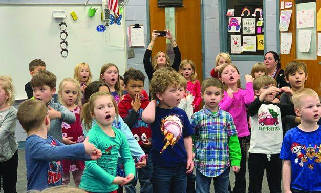 Golden Oldies Choir sings carols with students