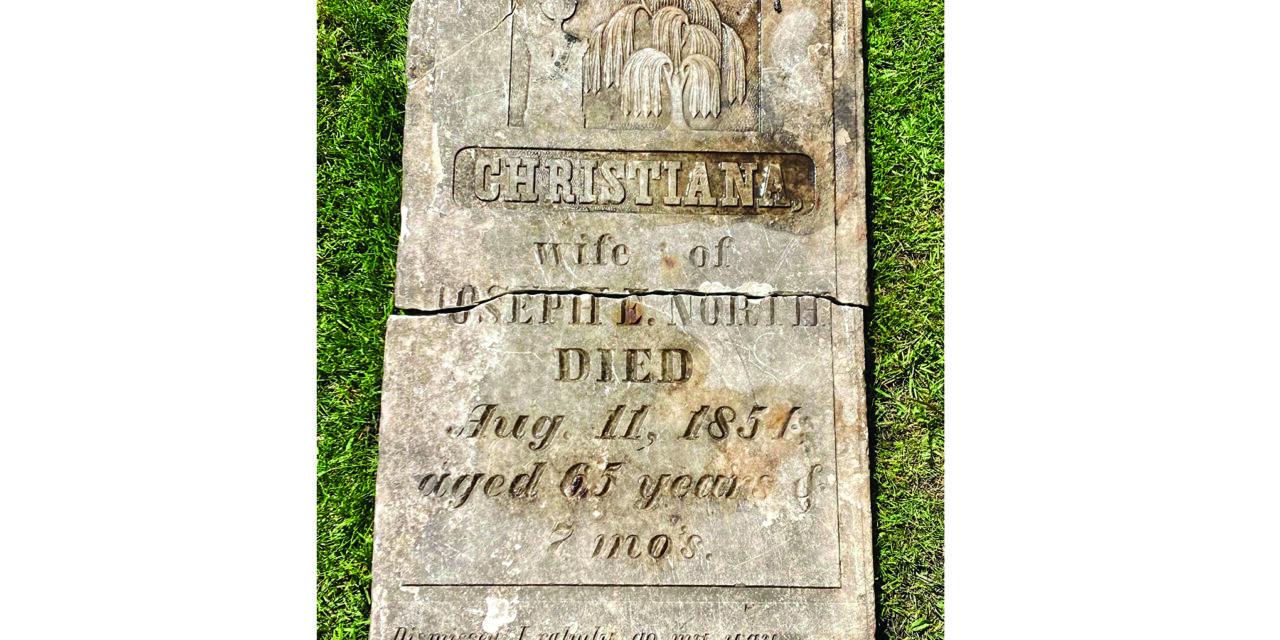 ER man unearths old gravestone in his backyard