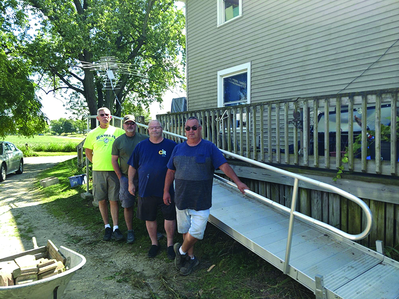Olivet Lions Club installs wheelchair  ramp for area resident