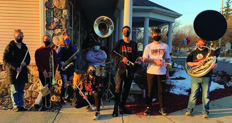 Charlotte Band Students Perform in the Cold to Raise Funds for the Band